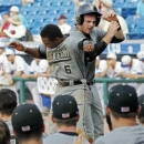 FILE - In this May 26, 2012, file photo, Vanderbilt's Tony Kemp and Conrad Gregor, right rear, celebrating with teammates after scoring in the ninth inning against Florida in an NCAA college baseball game during the Southeastern Conference tournament in Hoover, Ala. The Commodores won 28 of their last 41 games and would have gone to super regionals if they hadn't blown a six-run lead in the last two innings against N.C. State in the regional final. (AP Photo/Dave Martin, File)