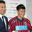 In this Aug. 6, 2013 photo, Vietnamese soccer player Le Cong Vinh, right, poses with Consadole Sapporo's President Yoshikazu Nonomura during a news conference as he joins the J-League team, in Sapporo, northern Japan. Le has been one of the biggest stars in Vietnam and Southeast Asia for a number of years. The J-League insists it is committed to developing football in Southeast Asia for the long-term and at a number of levels. (AP Photo/Kyodo News)