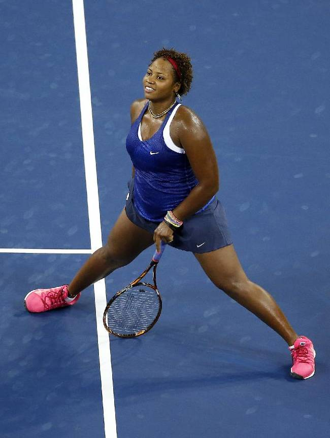 Taylor Townsend, of the United States, reacts after losing a point to Serena Williams during the opening round of the U.S. Open tennis tournament Tuesday, Aug. 26, 2014, in New York