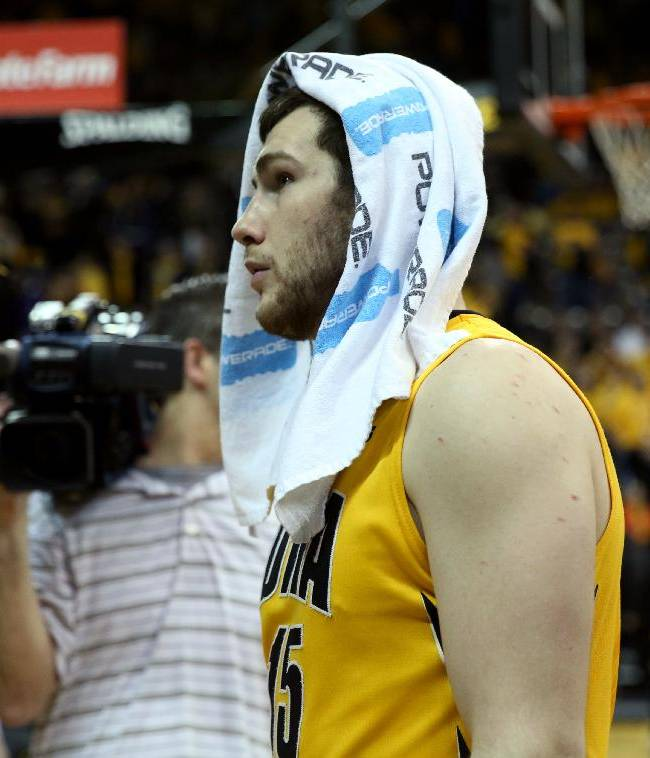 Iowa forward Zach McCabe walks off the floor after their 79-74 loss to Wisconsin during an NCAA college basketball game in Iowa City, Iowa, Saturday, Feb. 22, 2014. Wisconsin won 79-74