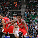 SALT LAKE CITY, UT - NOVEMBER 24: Jimmy Butler #21 of the Chicago Bulls handles the ball against the Utah Jazz during the game at EnergySolutions Arena on November 24, 2014 in Salt Lake City, Utah. (Photo by Melissa Majchrzak/NBAE via Getty Images)