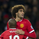 Manchester United's Marouane Fellaini, right, celebrates scoring with teammate Ashley Young during the English Premier League soccer match between Manchester United and Stoke City at Old Trafford Stadium, Manchester, England, Tuesday Dec. 2, 2014