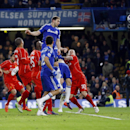 Chelsea's Branislav Ivanovic, top, scores during the English League Cup semifinal second leg soccer match between Chelsea and Liverpool at Stamford Bridge stadium in London, Tuesday, Jan. 27, 2015. (AP Photo/Kirsty Wigglesworth)