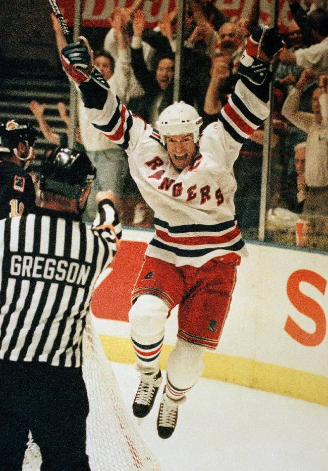 In this June 14, 1994 file photo,  New York Rangers Mark Messier celebrates his second period goal against the Vancouver Canucks in game seven of the Stanley Cup Finals at New York's Madison Square Garden.  It has taken nearly 20 years for Mark Messier's nephew to get back in action at Madison Square Garden. Back then, as an infant, he sat in the Stanley Cup as the New York Rangers celebrated their first NHL championship in 54 years