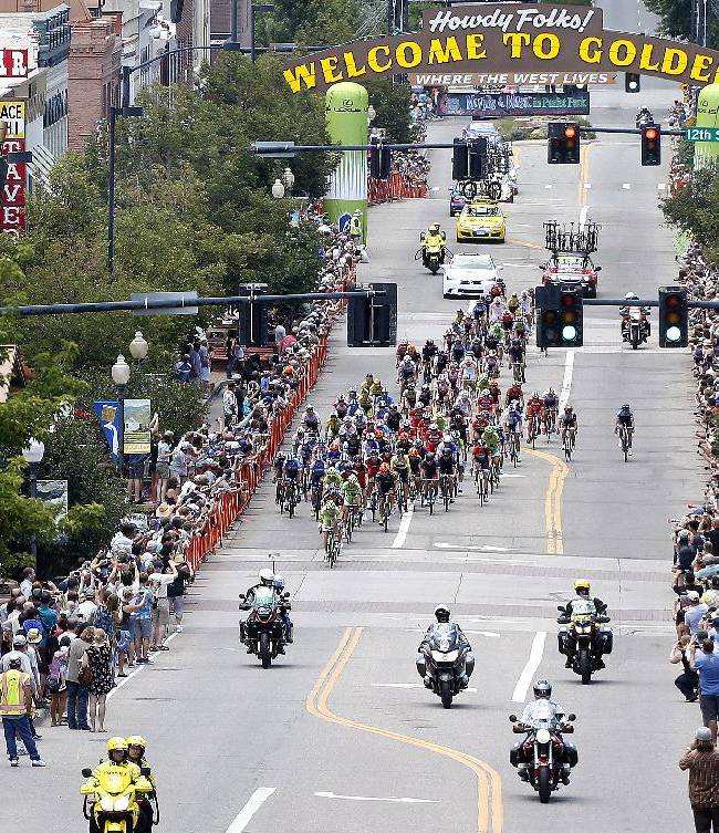 Riders are cheered on as they pass through Golden, Colo., during the seventh and final stage of the 2014 USA Pro Challenge bike race  Sunday Aug. 24, 2014. The 78-mile seventh stage finished up with several laps around downtown Denver