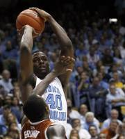 North Carolina's Harrison Barnes (40) shoots as Texas' J'Covan Brown (14) defends during the second half of an NCAA college basketball game in Chapel Hill, N.C., Wednesday, Dec. 21, 2011. North Carolina won 82-63. (AP Photo/Gerry Broome)