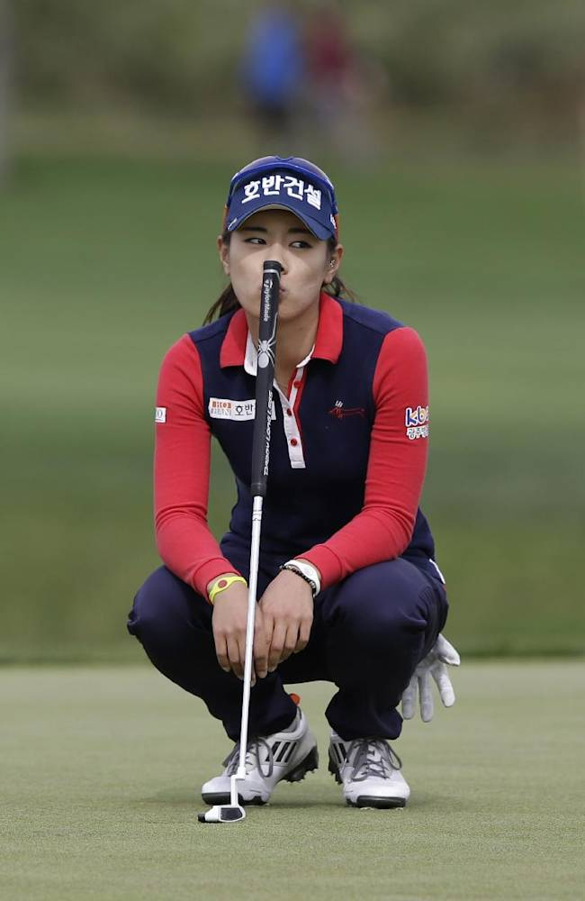 Ju Young Pak of South Korea waits for her putting during the second round of the LPGA KEB Hana Bank Championship golf tournament at Sky72 Golf Club in Incheon, west of Seoul, South Korea, Saturday, Oct. 19, 2013. Pak finished her second round with a six-under par 138
