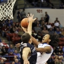 Louisiana Tech guard Kenneth Smith, right, drives past an Utah State defender during the first half of their NCAA college basketball game in Ruston, La., Thursday, Feb. 28, 2013. (AP Photo/Kita Wright)
