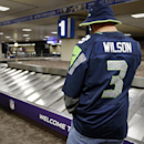 Seattle Seahawks fan Rob Kerben waits for his luggage, Friday, Jan. 30, 2015, at Sky Harbor Airport in Phoenix. The Seattle Seahawks play the New England Patriots in Super Bowl XLIX on Sunday, Feb. 1, 2015 The Associated Press