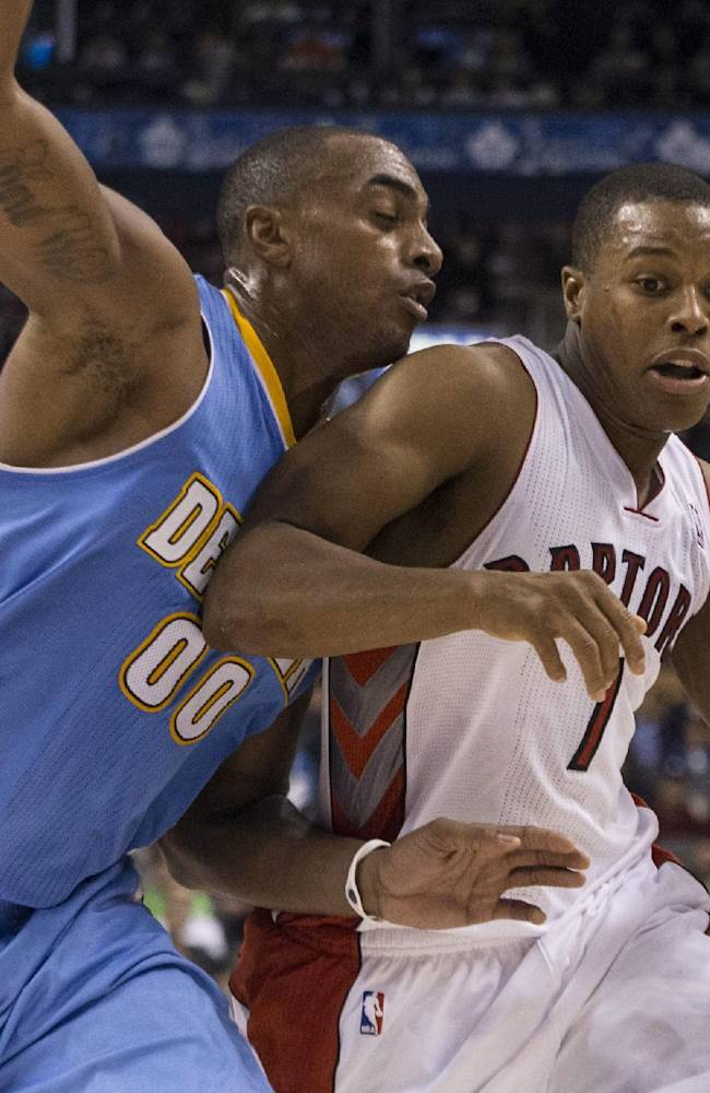 Toronto Raptors' Kyle Lowry, right, drives at Denver Nuggets' Darrell Arthur during the second half of an NBA basketball game on Sunday, Dec. 1, 2013, in Toronto