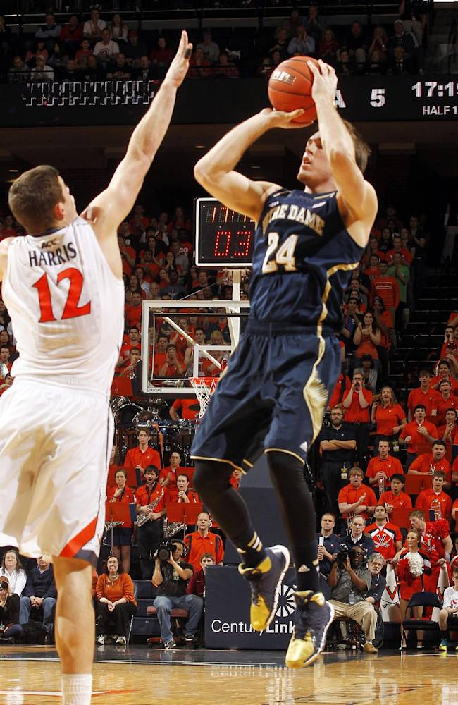Notre Dame's Pat Connaughton (24) shoots over Virginia guard Joe Harris (12) during an NCAA college basketball game Saturday, Feb. 22, 2014, in Charlottesville, Va