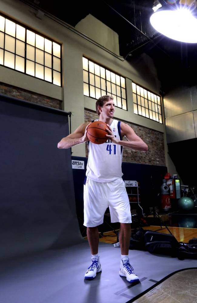 Dallas Mavericks power forward Dirk Nowitzki (41) of Germany poses for a photo during the basketball team's media day Monday, Sept. 30, 2013, in Dallas