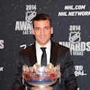 In this photo provided by the Las Vegas News Bureau, Patrice Bergeron of the Boston Bruins poses with the Frank J. Selke Trophy for best defensive forward at the 2014 NHL Awards at Wynn Las Vegas. Tuesday, June 24, 2014 The Associated Press