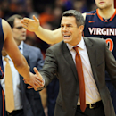 Virginia head coach Tony Bennett, right, greets Virginia's Anthony Gill, left, during a timeout in the second half of an NCAA college basketball game against Syracuse in Syracuse, N.Y., Monday, March 2, 2015. Virginia won 59-47. (AP Photo/Nick Lisi)