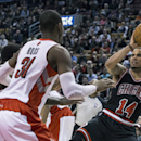 Chicago Bulls' D.J. Augustin (14) scores against Toronto Raptors during the second half of an NBA basketball game, Wednesday, Feb. 19, 2014 in Toronto The Associated Press