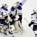 St. Louis Blues goalie Jake Allen (34), right wing Vladimir Tarasenko (91) and left wing Joakim Lindstrom (10) congratulate goalie Brian Elliott (1) after the Blues beat the New York Rangers 4-3 in a shootout during an NHL hockey game at Madison Square Ga