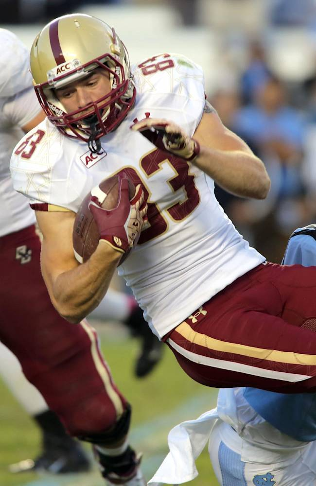 Boston College wide receiver Jeffrey Jay is tackled by North Carolina's Terry Shankle in the second half of an NCAA college football game in Chapel Hill, N.C., Saturday, Oct. 26, 2013. North Carolina won 34-10
