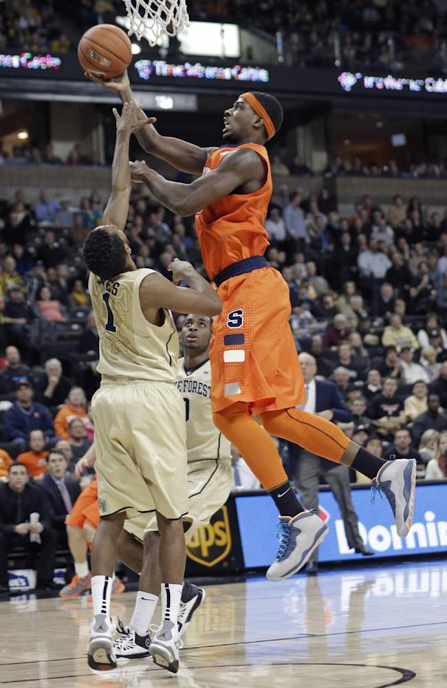 Syracuse's C.J. Fair, right, shoots over Wake Forest's Madison Jones, left, during the second half of an NCAA college basketball game in Winston-Salem, N.C., Wednesday, Jan. 29, 2014. Syracuse won 67-57