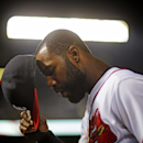 Atlanta Braves' Jason Heyward walks into the dugout in the ninth inning of a baseball game against the New York Mets, Thursday, April 10, 2014, in Atlanta. New York won 6-4 The Associated Press