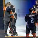 Former Anaheim Ducks star Teemu Selanne, left, is greeted by the Ducks' goalie Ilya Bryzgalov (80), Eric Brewer (2) and Clayton Stoner (3)at the Honda Center on Sunday, Jan. 11, 2015, in Anaheim, Calif. The Ducks retired Selanne's number before the NHL h