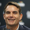 FILE - In this Jan. 13, 2015, file photo, NASCAR driver Jeff Gordon smiles during a media availability before a basketball game between the Washington Wizards and the San Antonio Spurs in Washington. Gordon says he will retire as a full-time driver after the 2015 season. (AP Photo/Alex Brandon, File)