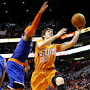 In this March 28, 2014 file photo, Phoenix Suns' Goran Dragic (1), of Slovenia, drives past New York Knicks' Carmelo Anthony during the second half of an NBA basketball game, in Phoenix. Dragic was selected Wednesday, April 23, 2014 as the league's Most I