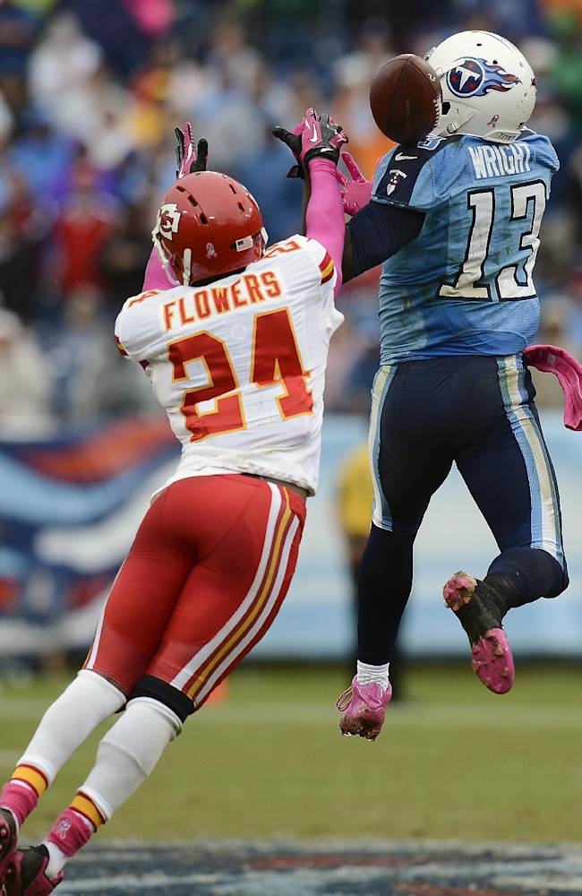 Kansas City Chiefs cornerback Brandon Flowers (24) breaks up a pass intended for Tennessee Titans wide receiver Kendall Wright (13) late in the fourth quarter of an NFL football game on Sunday, Oct. 6, 2013, in Nashville, Tenn. Chiefs defensive back Quintin Demps intercepted the deflected pass