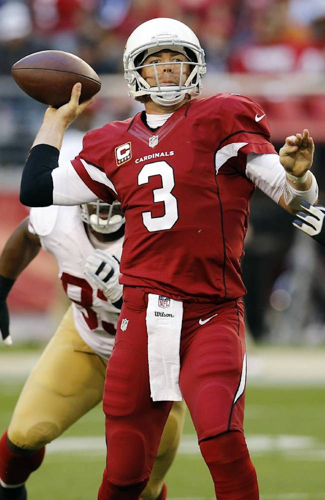 Arizona Cardinals quarterback Carson Palmer (3) throw under pressure from San Francisco 49ers nose tackle Ian Williams during the second half of an NFL football game, Sunday, Dec. 29, 2013, in Glendale, Ariz