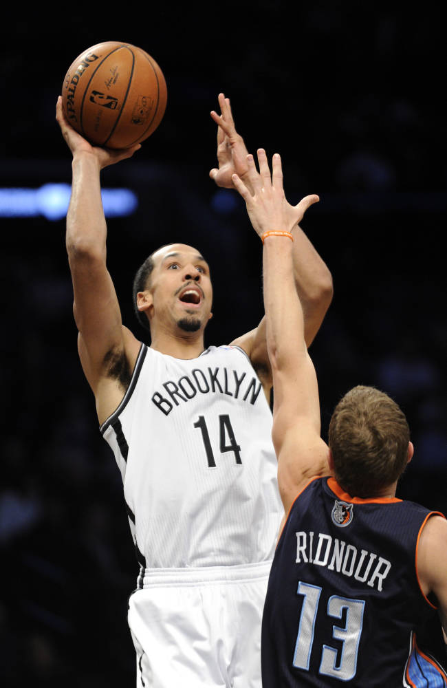 Brooklyn Nets' Shaun Livingston (14) shoots over Charlotte Bobcats' Luke Ridnour during the second quarter of an NBA basketball game Wednesday, March 19, 2014, at Barclay's Center in New York