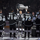 Los Angeles Kings right wing Dustin Brown raises the Stanley Cup before raising their second Stanley Cup Championship banner prior to an NHL hockey game against the San Jose Sharks, Wednesday, Oct. 8, 2014, in Los Angeles The Associated Press