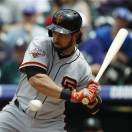 San Francisco Giants leadoff hitter Angel Pagan avoids an inside pitch against the Colorado Rockies in the first inning of a baseball game in Denver on Sunday, May 19, 2013. (AP Photo/David Zalubowski)