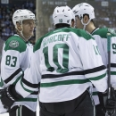 Dallas Stars' Ales Hemsky (83) is congratulated by Shawn Horcoff (10) and Jason Spezza (90) after scoring against the Toronto Maple Leafs during the third period of an NHL hockey game, Tuesday, Dec. 2, 2014 in Toronto The Associated Press