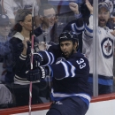 Winnipeg Jets' Dustin Byfuglien (33) celebrates his goal against the Philadelphia Flyers during first-period NHL hockey game action in Winnipeg , Manitoba, Friday, Nov. 15, 2013 The Associated Press