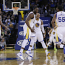 Golden State Warriors guard Jordan Crawford (55) celebrates after dunking with teammates Marreese Speights (5), Draymond Green, center, and Harrison Barnes (40) during the second half of an NBA basketball game against the Sacramento Kings on Friday, April