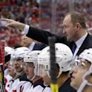 FILE - In this Dec. 21, 2013, file photo, then-New Jersey Devils head coach Peter DeBoer directs his team in the first period of an NHL hockey game against the Washington Capitals in Washington. The San Jose Sharks will hire Peter DeBoer as their new head coach. A person familiar with the search said Wednesday, May 27, 2015, that DeBoer will be formally introduced later this week. The person spoke on condition of anonymity because the team had not announced the hire yet. ESPN first reported the move.(AP Photo/Alex Brandon, File)