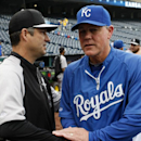 Chicago White Sox manager Robin Ventura, left, and Kansas City Royals manager Ned Yost, right, visit before their baseball game at Kauffman Stadium in Kansas City, Mo., Wednesday, Sept. 17, 2014. (AP Photo/Colin E. Braley)
