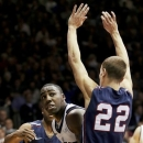 Butler's Roosevelt Jones (21) goes to the basket against Pennsylvania's Steve Rennard (22) during the first half of an NCAA college basketball game, Wednesday, Jan. 2, 2013, in Indianapolis. (AP Photo/Darron Cummings)