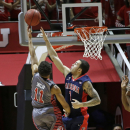 Utah guard Brandon Taylor (11) shoots as Arizona guard Gabe York (1) defends in the first half of an NCAA college basketball game Saturday, Feb. 28, 2015, in Salt Lake City. (AP Photo/Rick Bowmer)