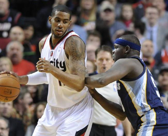 Memphis Grizzlies' Zach Randolph (50) defends against Portland Trail Blazers' LaMarcus Aldridge (12) during the first half of an NBA basketball game in Portland, Ore., Sunday March 30, 2014