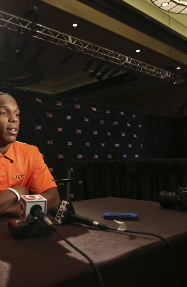 Oklahoma State corner back Kevin Peterson speaks to reporters during the NCAA college Big 12 Conference football media days in  Dallas, Monday, July 21, 2014