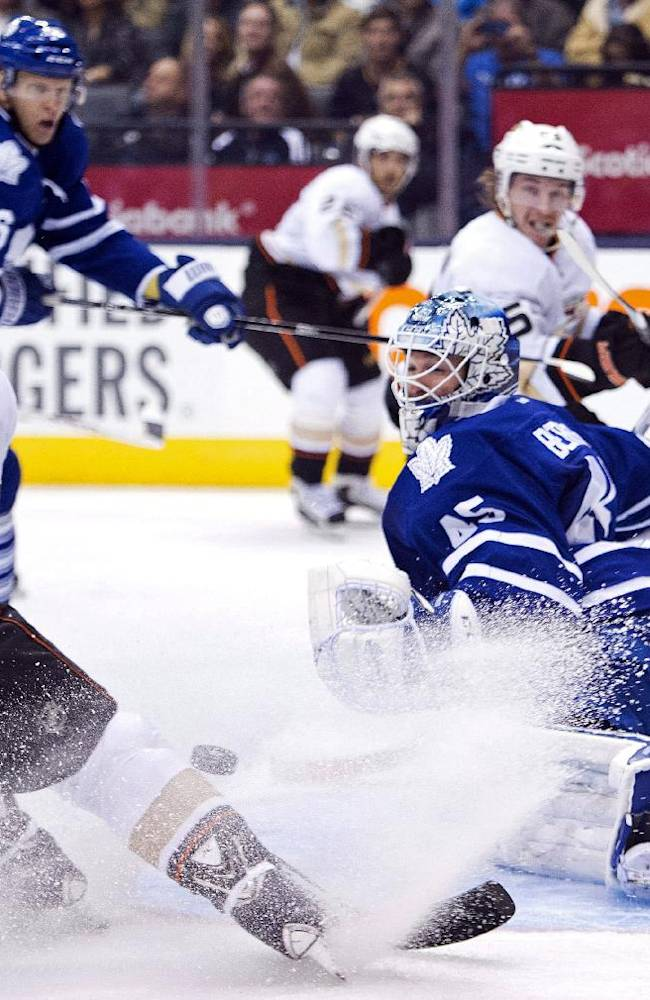 Toronto Maple Leafs goalie Jonathan Bernier, right, makes save on Anaheim Ducks forward Teemu Selanne (8), of Finland, during the third period of an NHL hockey game in Toronto on Tuesday, Oct. 22, 2013