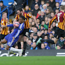 Chelsea's Didier Drogba, left, competes for the ball with Bradford's Rory McArdle during the English FA Cup 4th round soccer match between Bradford City and Chelsea at Stamford Bridge, London, England, Saturday, Jan. 24, 2015