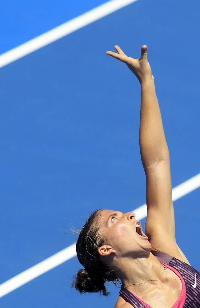 Sara Errani of Italy serves to compatriot Roberta Vinci during their women's singles match at the Sydney International tennis tournament in Sydney, Australia, Sunday, Jan. 5, 2014