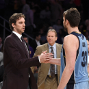 Los Angeles Lakers center Pau Gasol, left, of Spain, and his brother Memphis Grizzlies center Marc Gasol, of Spain, shake hands after an NBA basketball game, Sunday, April 13, 2014, in Los Angeles. The Grizzlies won 102-90. (AP Photo/Mark J. Terrill)