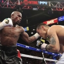 Floyd Mayweather Jr. (L) of the U.S. punches at Marcos Maidana of Argentina during their WBC/WBA welterweight unification fight at the MGM Grand Garden Arena in Las Vegas, Nevada, May 3, 2014. REUTERS/Steve Marcus