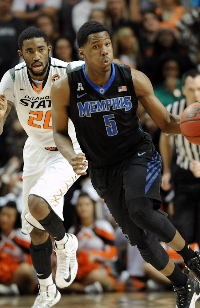 Oklahoma State post Michael Cobbins (20) chases Memphis guard Nick King (5) during the second half of an NCAA college basketball game in Stillwater, Okla., Tuesday, Nov. 19, 2013. King led Memphis scoring with 23 points in the 80-101 loss to Oklahoma State