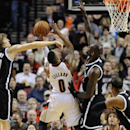 Brooklyn Nets' Andrei Kirilenko (47) and Kevin Garnett (2) defend a shot by Portland Trail Blazers' Damian Lillard (0)) during the first half of an NBA basketball game in Portland, Ore., Wednesday, Feb. 26, 2014 The Associated Press