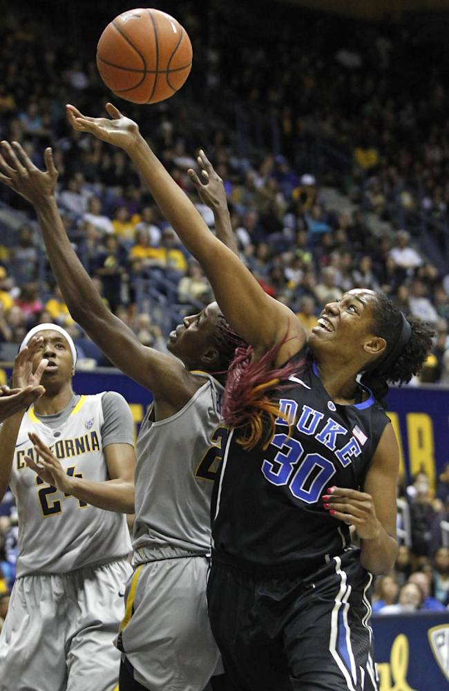 Duke's Amber Henson (30) rebounds in front of California's Gennifer Brandon during the first half of an NCAA college basketball game, Sunday, Nov. 10, 2013 in Berkeley, Calif