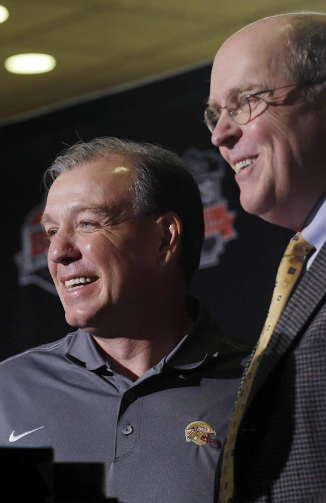 Florida State head coach Jimbo Fisher, left, and BCS executive director Bill Hancock pose with The Coaches' Trophy during a news conference for the BCS National Championship NCAA college football game Tuesday, Jan. 7, 2014, in Newport Beach, Calif. Florida State beat Auburn 34-31 to win the championship the night before