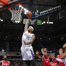 DeMarcus Cousins #15 of the Sacramento Kings dunks the ball against Terrance Jones #6 of the Houston Rockets at Sleep Train Arena on February 25, 2014 in Sacramento, California. (Photo by Rocky Widner/NBAE via Getty Images)